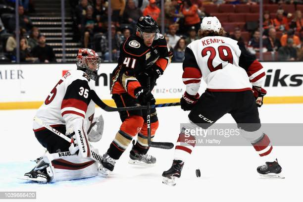 Brandon Montour of the Anaheim Ducks shoots the puck past Robbie Russo of the Arizona Coyotes during the first period of an NHL preseason game at...