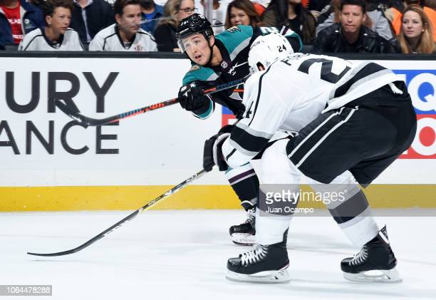 Brandon Montour of the Anaheim Ducks shoots the puck with pressure from Derek Forbort of the Los Angeles Kings during the second period of the game...