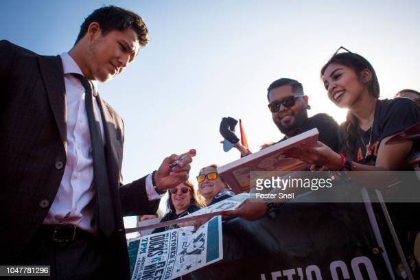 Brandon Montour of the Anaheim Ducks signs autographs prior to opening night against the Detroit Red Wings on October 8 2018 at Honda Center in...