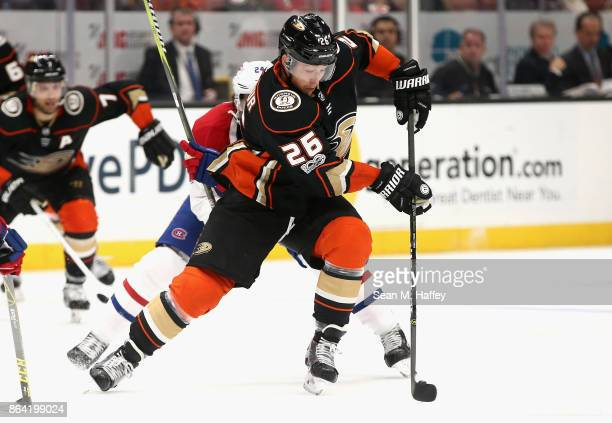 Brandon Montour of the Anaheim Ducks skates past Phillip Danault of the Montreal Canadiens during the third period of a game at Honda Center on...