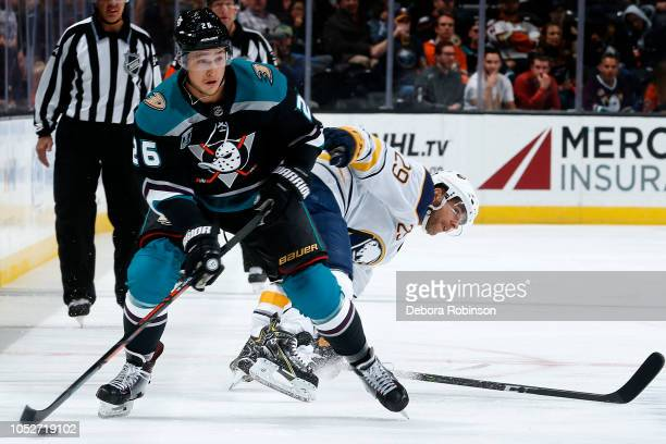 Brandon Montour of the Anaheim Ducks skates with the puck against Jason Pominville of the Buffalo Sabres during the game on October 21 2018 at Honda...