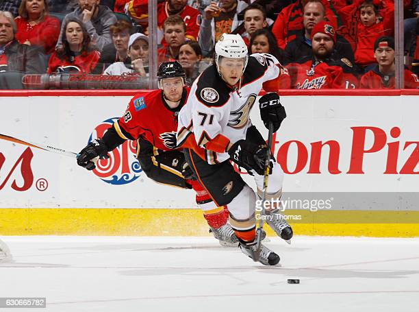 Brandon Montour of the Anaheim Ducks skates with the puck during his first NHL game against the Calgary Flames at Scotiabank Saddledome on December...