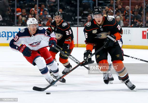 Brandon Montour of the Anaheim Ducks skates with the puck with pressure from Riley Nash of the Columbus Blue Jackets during the first period of the...