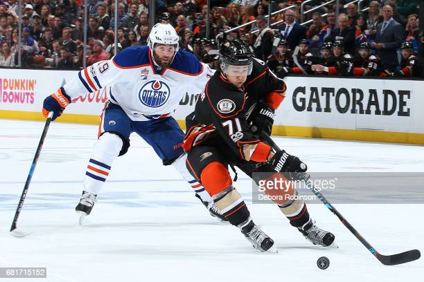 Brandon Montour of the Anaheim Ducks skates with the puck with pressure from Patrick Maroon of the Edmonton Oilers in Game Seven of the Western...