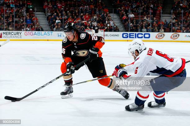 Brandon Montour of the Anaheim Ducks skates with the puck with pressure from Michal Kempny of the Washington Capitals during the game on March 6 2018...