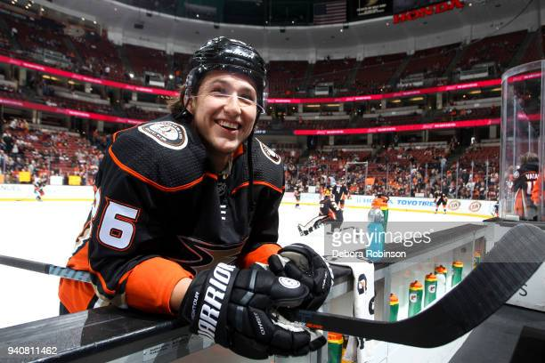Brandon Montour of the Anaheim Ducks smiles while chatting with a person on the bench during warmup before the game before the game against the...