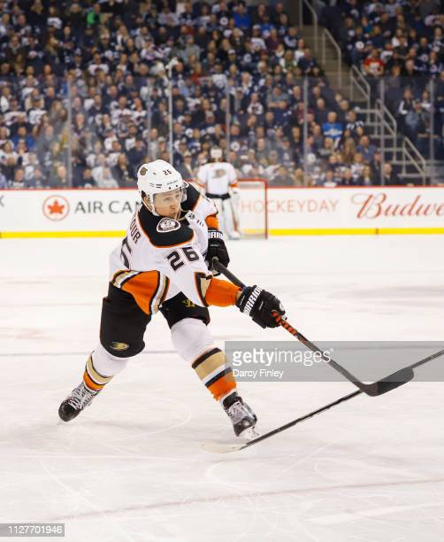 Brandon Montour of the Anaheim Ducks takes a shot on goal during third period action against the Winnipeg Jets at the Bell MTS Place on February 2...