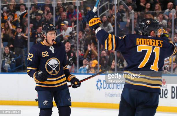 Brandon Montour of the Buffalo Sabres celebrates with Evan Rodrigues after his third period goal during an NHL game against the Pittsburgh Penguins...