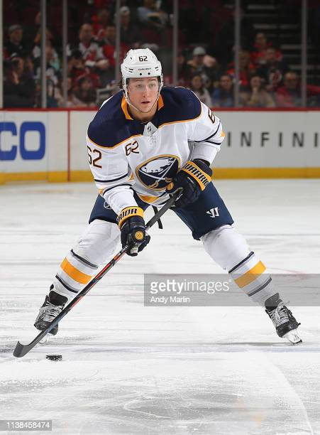 Brandon Montour of the Buffalo Sabres plays the puck against the New Jersey Devils during the game at Prudential Center on March 25 2019 in Newark...