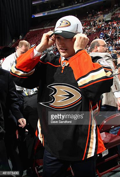 Brandon Montour puts on his hat after being selected 55th overall by the Anaheim Ducks during the 2014 NHL Entry Draft at Wells Fargo Center on June...