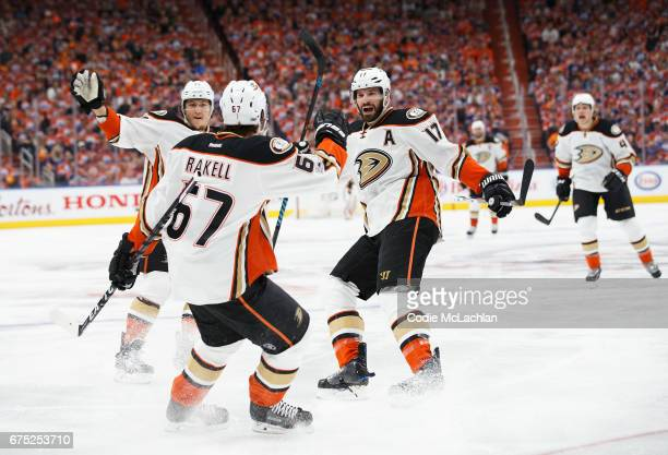 Brandon Montour Rickard Rakell and Ryan Kesler of the Anaheim Ducks celebrate a goal against the Edmonton Oilers in Game Three of the Western...