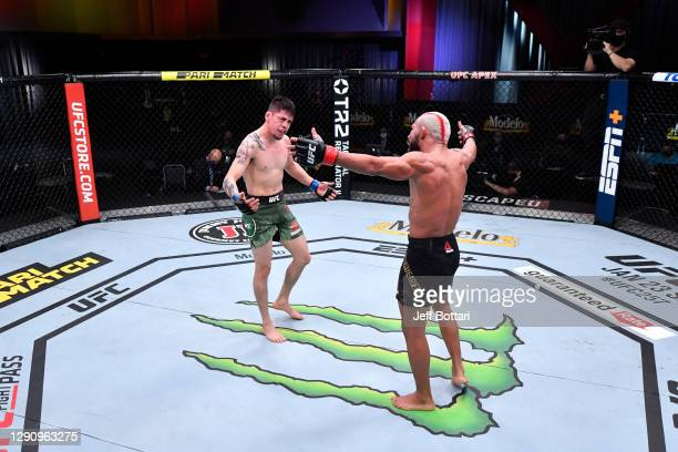 Brandon Moreno of Mexico and Deiveson Figueiredo of Brazil react after their flyweight championship bout during the UFC 256 event at UFC APEX on...