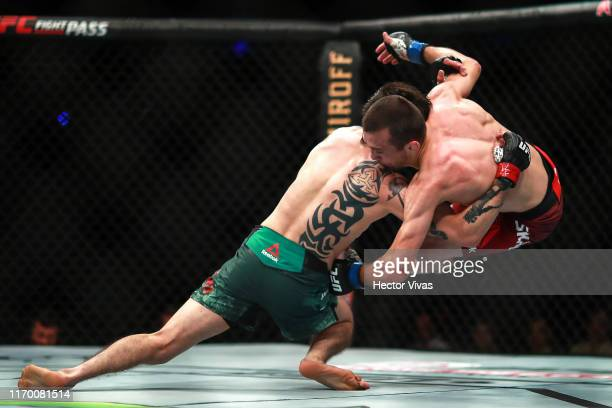Brandon Moreno of Mexico attempts to submit Askar Askarov of Russia in their flyweight bout during UFC Fight Night event at Arena Ciudad de Mexico on...