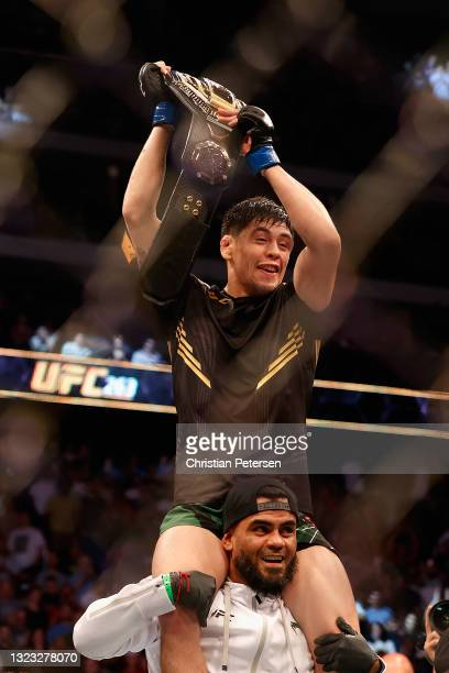 Brandon Moreno of Mexico celebrates after defeating Deiveson Figueiredo of Brazil to win the flyweight championship during their UFC 263 match at...