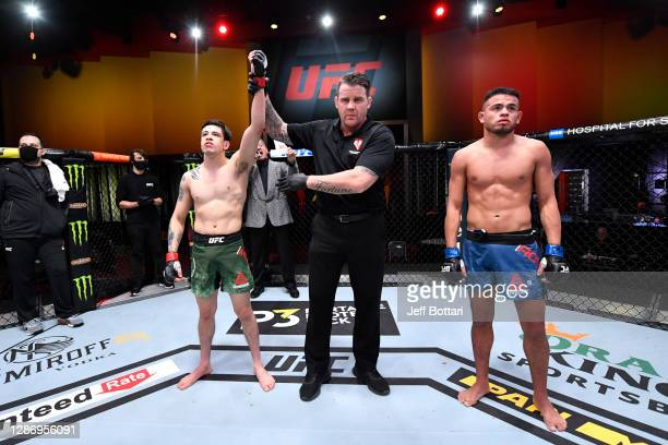 Brandon Moreno of Mexico celebrates his TKO victory over Brandon Royval in their flyweight bout during the UFC 255 event at UFC APEX on November 21,...