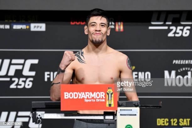 Brandon Moreno of Mexico poses on the scale during the UFC 256 weigh-in at UFC APEX on December 11, 2020 in Las Vegas, Nevada.