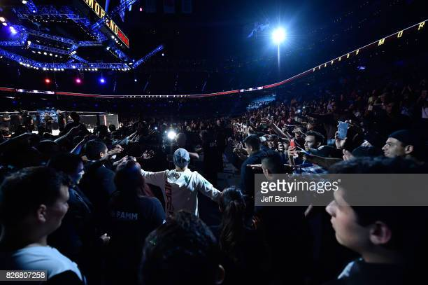 Brandon Moreno of Mexico prepares to enter the Octagon before facing Sergio Pettis in their flyweight bout during the UFC Fight Night event at Arena...