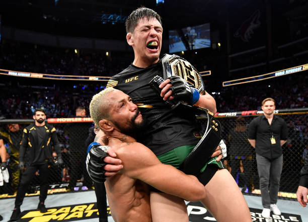 Brandon Moreno of Mexico reacts after submitting Deiveson Figueiredo of Brazil to win the UFC flyweight championship fight during the UFC 263 event...