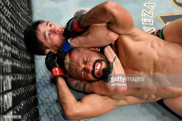 Brandon Moreno of Mexico secures a rear choke submission against Deiveson Figueiredo of Brazil in their UFC flyweight championship fight during the...
