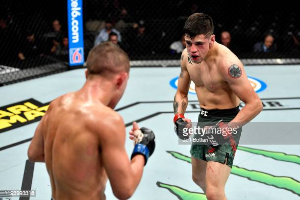 Brandon Moreno of Mexico stares down Kai Kara-France of New Zealand in their flyweight bout during the UFC 245 event at T-Mobile Arena on December...