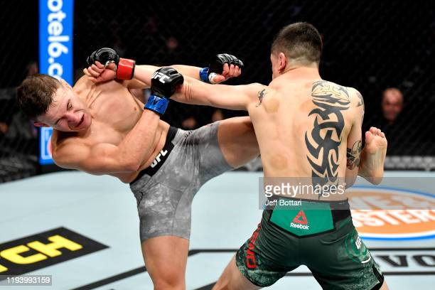 Brandon Moreno of Mexico strikes Kai KaraFrance of New Zealand in their flyweight bout during the UFC 245 event at TMobile Arena on December 14 2019...