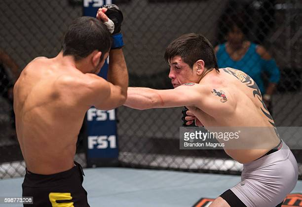 Brandon Moreno punches Alexandre Pantoja during the filming of The Ultimate Fighter Team Benavidez vs Team Cejudo at the UFC TUF Gym on July 13 2016...