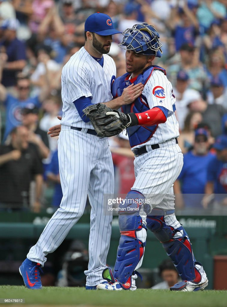 Brandon Morrow #15 (L) and Willson Contreras #40 of the Chicago Cubs celebrate a win against the San Francisco Giants at Wrigley Field on May 25, 2018 in Chicago, Illinois. The Cubs defeated the Giants 6-2.