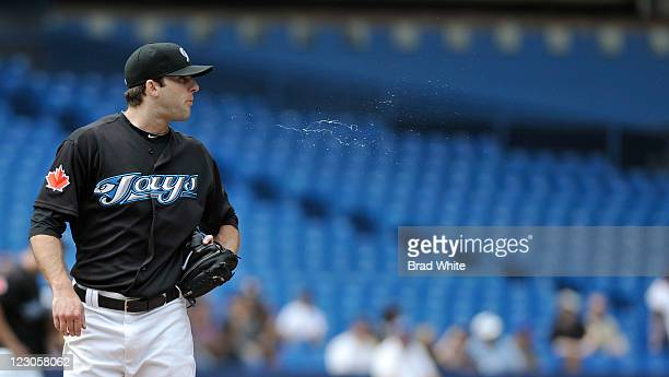 Brandon Morrow of the Toronto Blue Jays spits during a break in MLB game action against the Tampa Bay Rays August 28 2011 at Rogers Centre in Toronto...