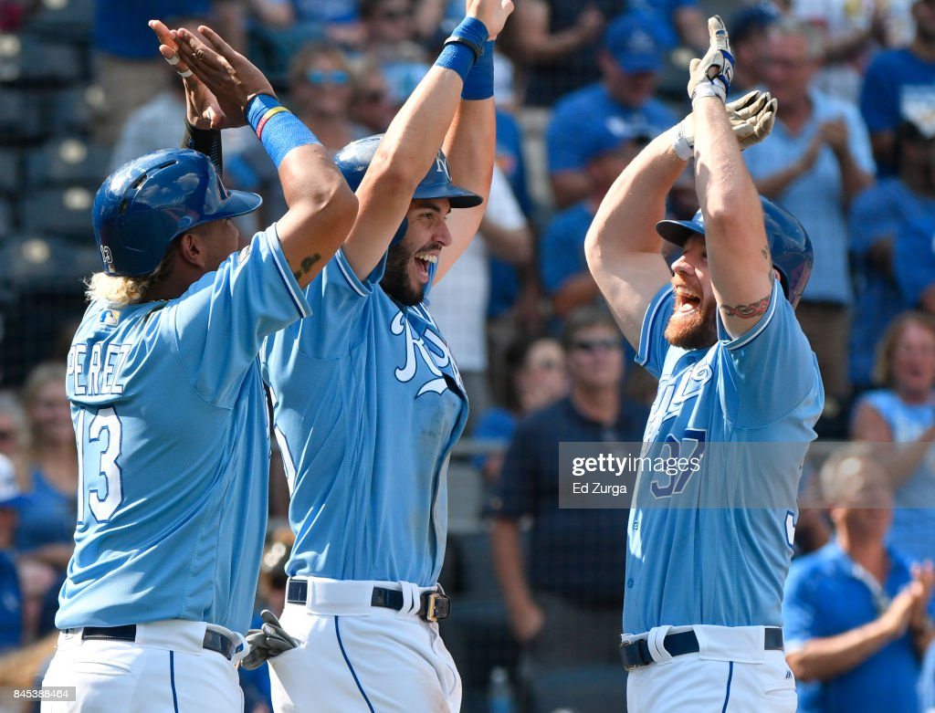 Brandon Moss #37 of the Kansas City Royals celebrate his three-run home run with Salvador Perez #13 and Eric Hosmer #35 in the seventh inning against the Minnesota Twins at Kauffman Stadium on September 10, 2017 in Kansas City, Missouri.