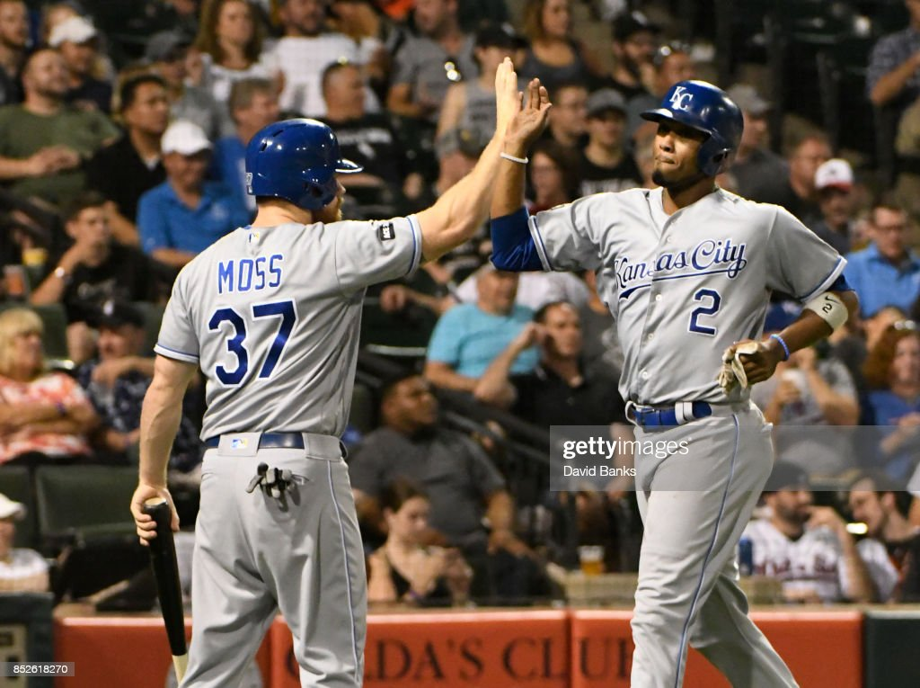 Brandon Moss #37 of the Kansas City Royals greets Alcides Escobar #2 after scoring against the Chicago White Sox during the seventh inning on September 23, 2017 at Guaranteed Rate Field in Chicago, Illinois.