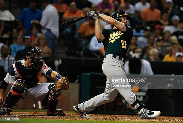 Brandon Moss of the Oakland Athletics belts a two-run home run in the eighth inning against the Houston Astros at Minute Maid Park on July 23, 2013...