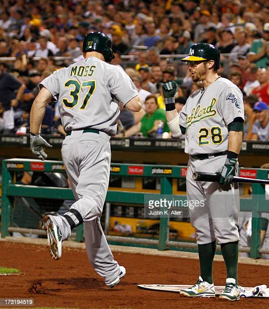 Brandon Moss of the Oakland Athletics celebrates after hitting a two run home run in the fourth inning against the Pittsburgh Pirates during the game...