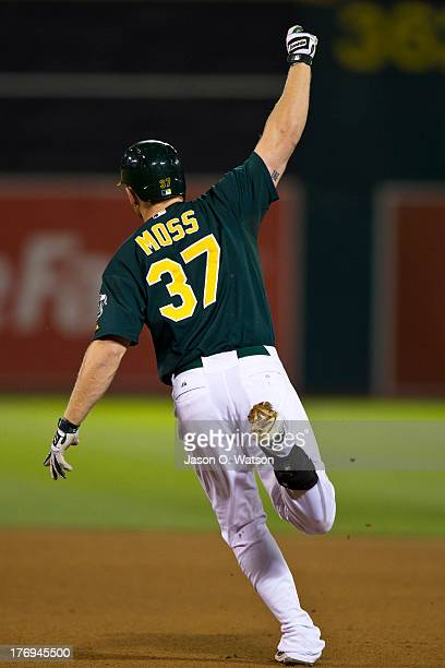 Brandon Moss of the Oakland Athletics celebrates after hitting a walk off home run against the Seattle Mariners during the ninth inning at Oco...