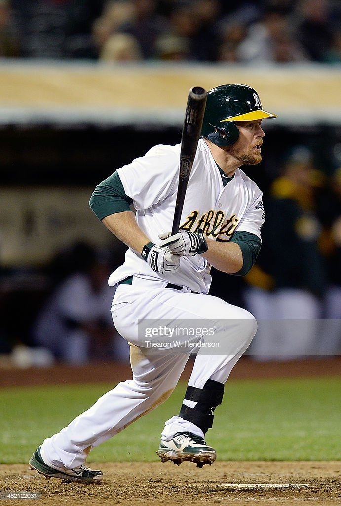 Brandon Moss #37 of the Oakland Athletics hits an RBI single driving in Josh Donaldson #20 (not pictured) against the Cleveland Indians in the bottom of the seventh inning at O.co Coliseum on April 2, 2014 in Oakland, California.
