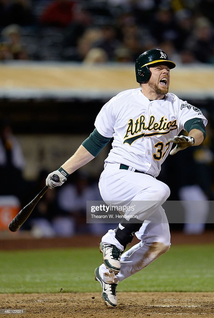 Brandon Moss #37 of the Oakland Athletics reacts after fouling a ball off his foot against the Cleveland Indians in the bottom of the seventh inning at O.co Coliseum on April 2, 2014 in Oakland, California.
