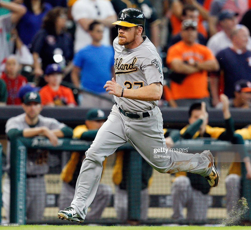 Brandon Moss #37 of the Oakland Athletics scores in the ninth inning at Minute Maid Park on April 27, 2014 in Houston, Texas.