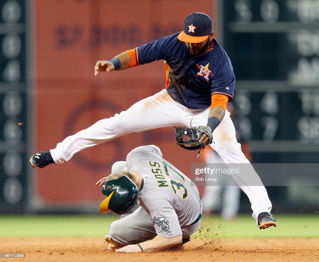Brandon Moss #37 of the Oakland Athletics steals second base as Jonathan Villar #6 of the Houston Astros is late on the tag in the ninth inning at Minute Maid Park on April 27, 2014 in Houston, Texas.