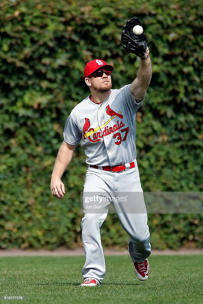 Brandon Moss #37 of the St. Louis Cardinals makes a catch for an out against the Chicago Cubs during the fifth inning at Wrigley Field on September 24, 2016 in Chicago, Illinois.