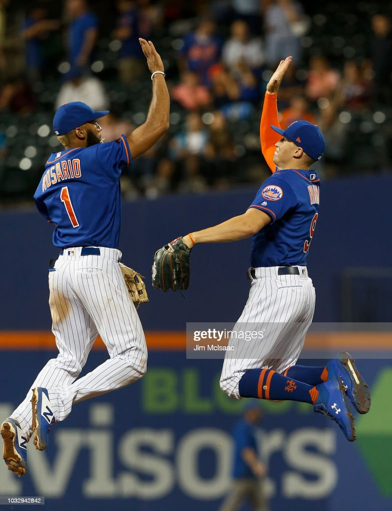 Brandon Nimmo #9 and Amed Rosario #1 of the New York Mets celebrate after defeating the Miami Marlins in game two of a doubleheader at Citi Field on September 13, 2018 in the Flushing neighborhood of the Queens borough of New York City.