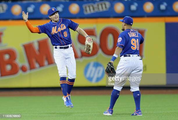 Brandon Nimmo and Carlos Gomez of the New York Mets celebrate the win over the Washington Nationals at Citi Field on May 20 2019 in the Flushing...