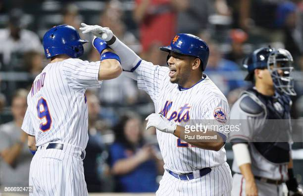 Brandon Nimmo congratulates Dominic Smith of the New York Mets after Smith hit a home run during the Mets last home game of the season in an MLB...