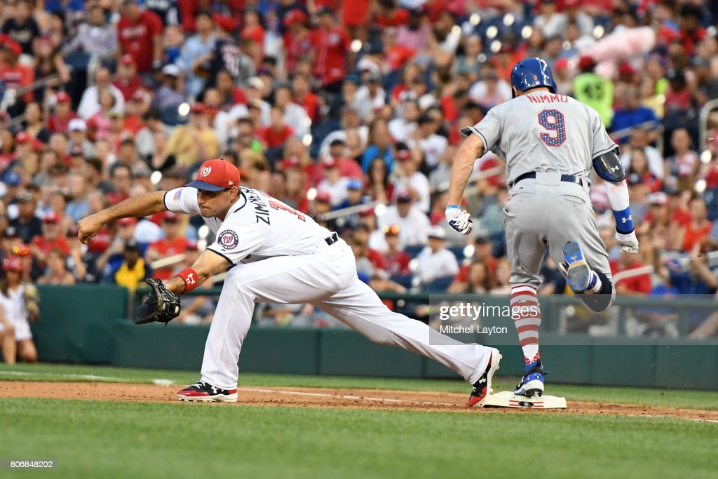 Brandon Nimmo #9 of the New York Mets beats the throw to Ryan Zimmerman #11 of the Washington Nationals for an infield single in the eighth inning during a baseball game at Nationals Park on July 3, 2017 in Washington, DC.
