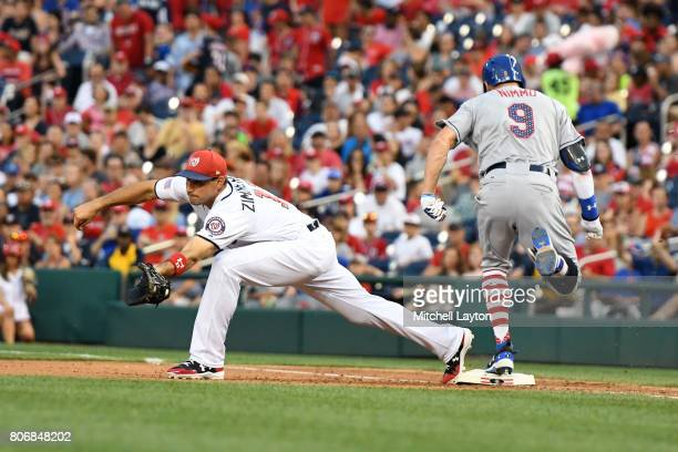 Brandon Nimmo of the New York Mets beats the throw to Ryan Zimmerman of the Washington Nationals for an infield single in the eighth inning during a...