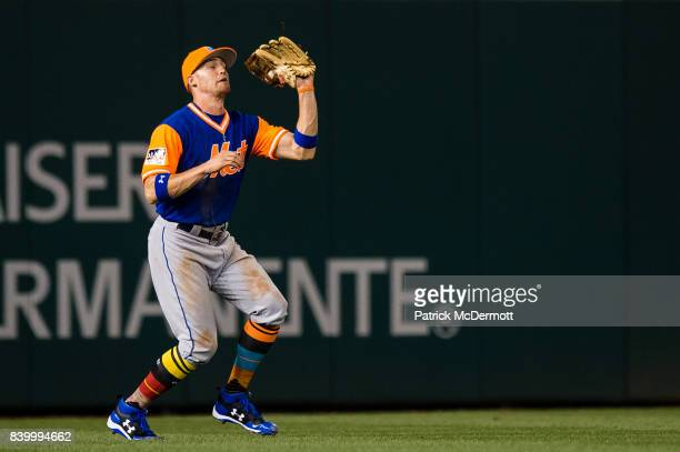 Brandon Nimmo of the New York Mets catches a fly ball hit by Adam Lind of the Washington Nationals in the second inning during Game Two of a...