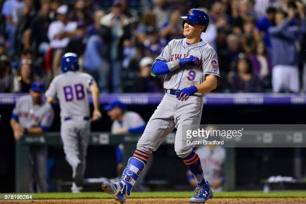 Brandon Nimmo of the New York Mets celebrates after hitting a seventh inning solo home run against the Colorado Rockies at Coors Field on June 18...