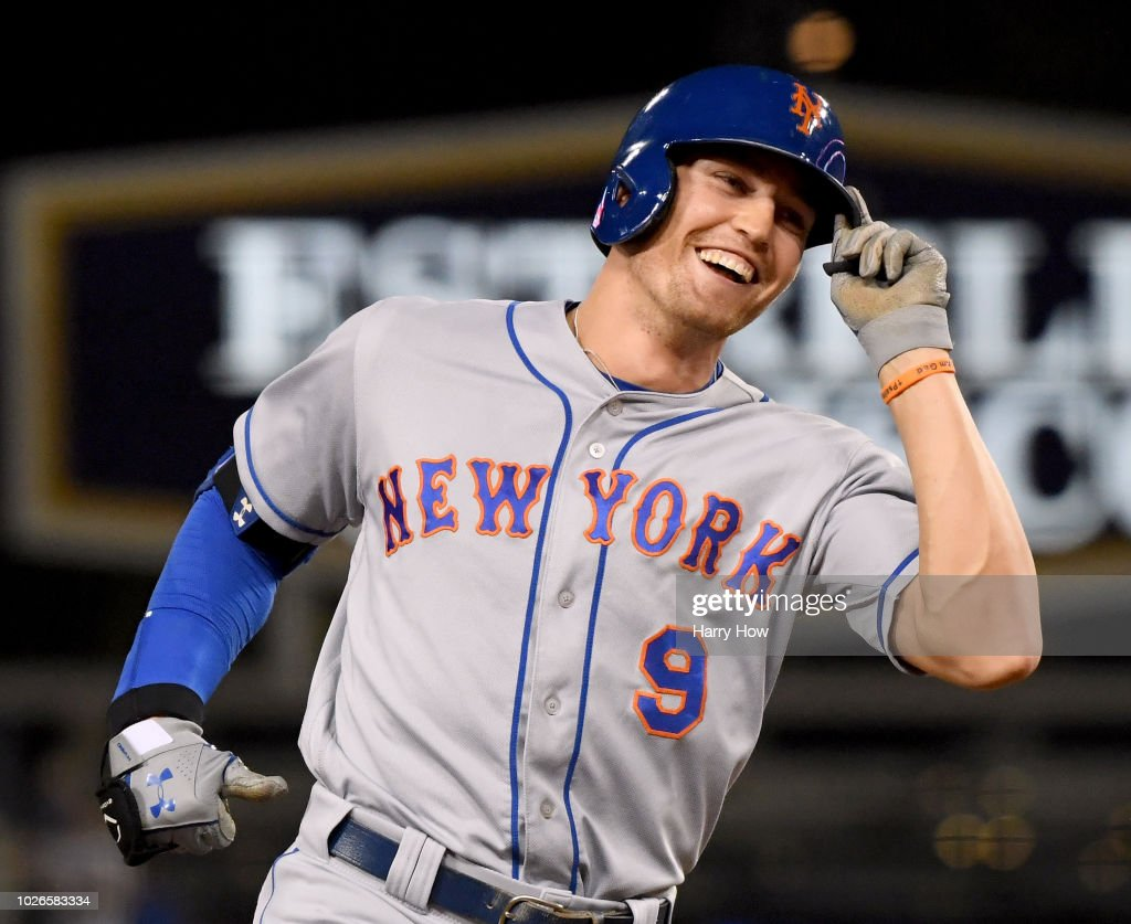 Brandon Nimmo #9 of the New York Mets celebrates his three run homerun to take a 4-1 lead over the Los Angeles Dodgers during the ninth inning at Dodger Stadium on September 3, 2018 in Los Angeles, California.