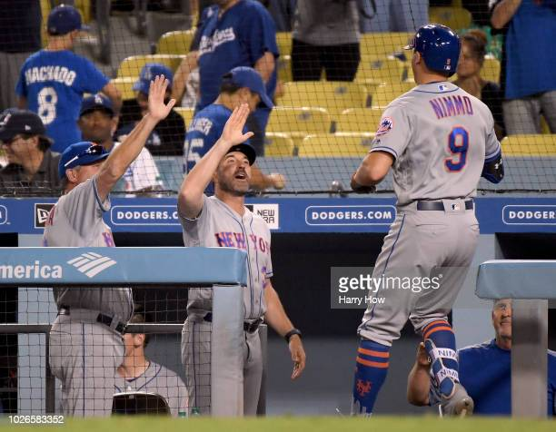 Brandon Nimmo of the New York Mets celebrates his three run homerun with manager Mickey Callaway to take a 41 lead over the Los Angeles Dodgers...
