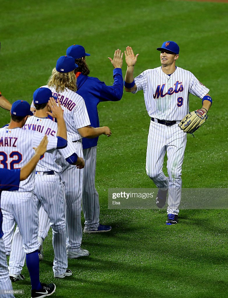 Brandon Nimmo #9 of the New York Mets celebrates the 10-2 win over the Chicago Cubs at Citi Field on July 1, 2016 in the Flushing neighborhood of the Queens borough of New York City.