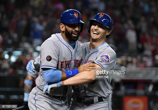Brandon Nimmo of the New York Mets celebrates with teammate Jose Bautista after hitting a two run home run during the ninth inning against the...