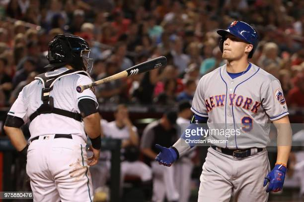Brandon Nimmo of the New York Mets flips his bat after a strike out against the Arizona Diamondbacks during the third inning of the MLB game at Chase...